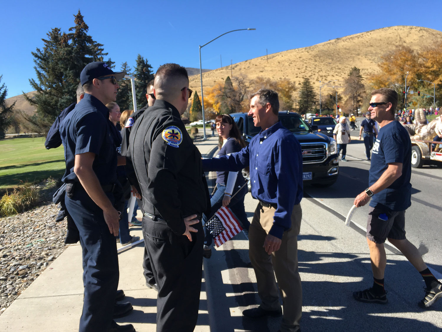 Jared speaking with law enforcement at Nevada Day Parade